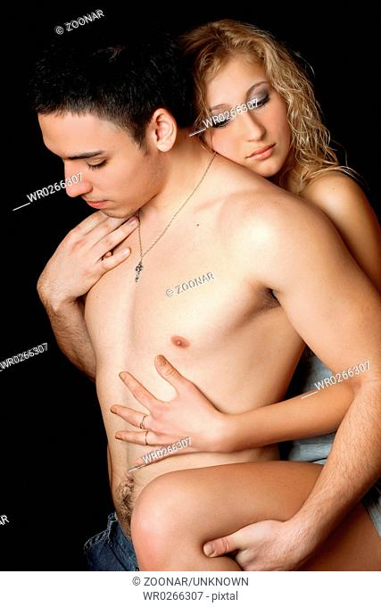Portrait of attractive loving young couple. Isolated