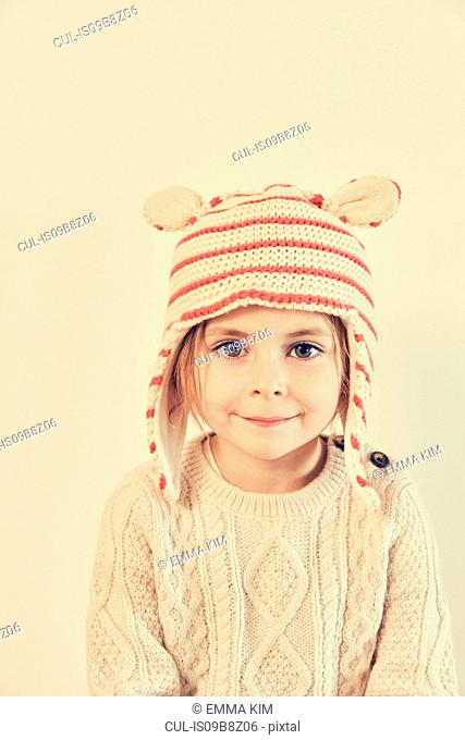 Portrait of girl in striped knit hat with ears
