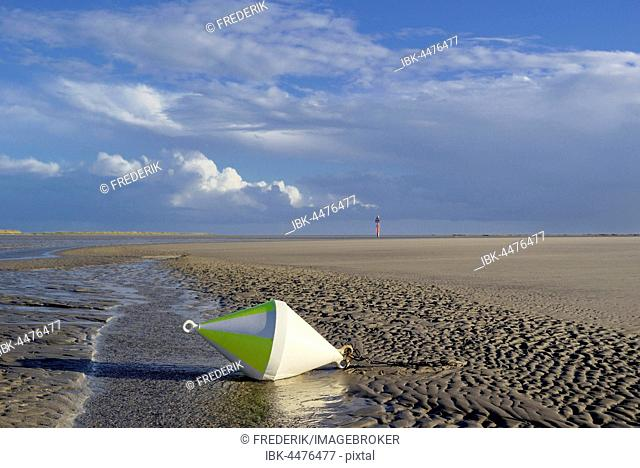 Buoy on sandbank with receding water, Sankt Peter-Ording, Schleswig-Holstein Wadden Sea National Park, North Frisia, Schleswig-Holstein, Germany