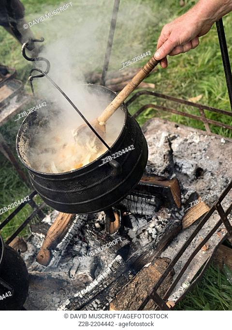 soldier camp cooking pot, of the Stuart era, the 17th century, (reign of king Charles 1st) worn by actors .They are reenacting the siege of Bolsover Castle