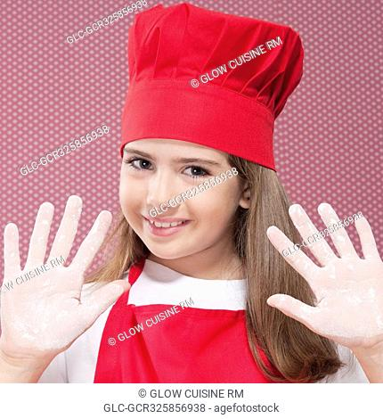 Girl showing her hands with flour
