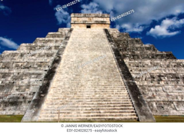 Blurred background of View up the stairs of Kukulkan Pyramid at Chichen Itza, Yucatan, Mexico