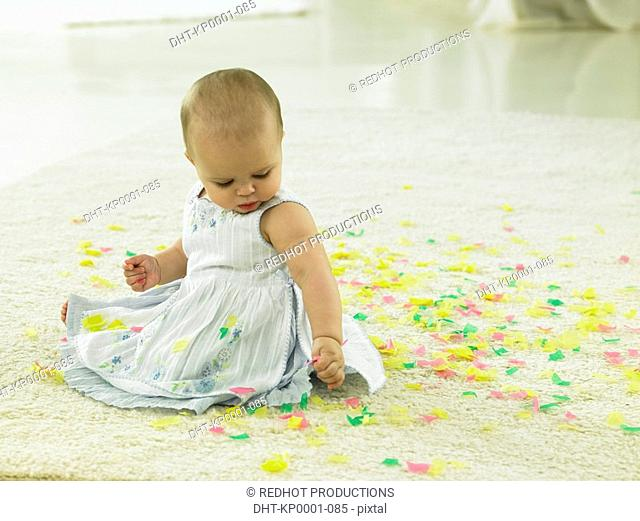 Baby with confetti around her
