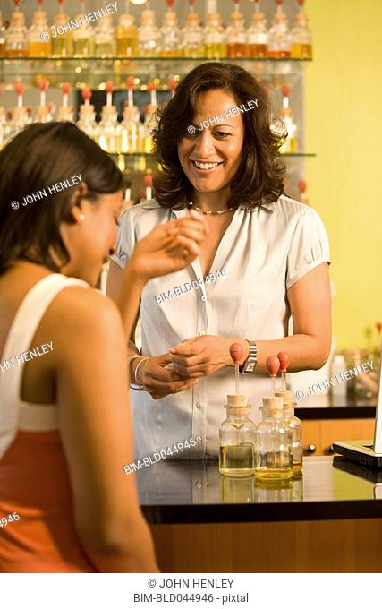 Hispanic female sales clerk helping customer