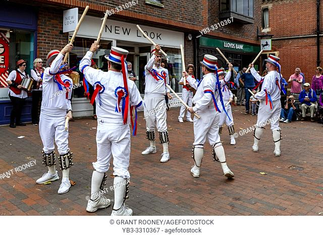 A Group Of Morris Dancers Perform In The High Street During The Annual Lewes Folk Festivalâ. . s Day of Dance, Lewes, Sussex, UK