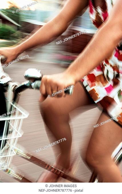 A woman in a flowery dress on a bike, Sweden