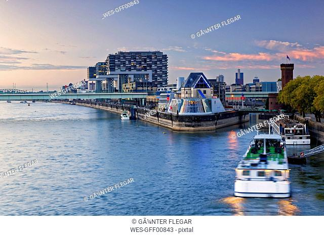 Germany, Cologne, view to Crane Houses at Rhine harbour and chocolate museum in the foreground