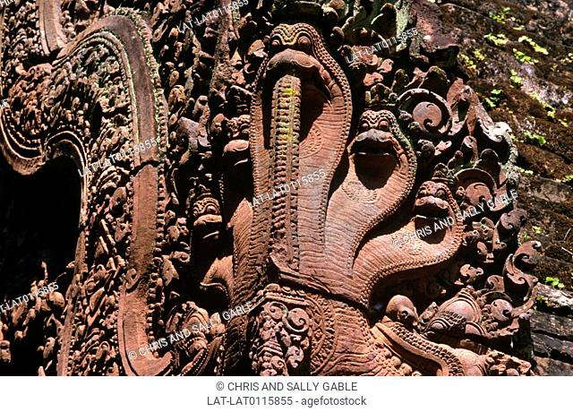 Banteay Srei is a 10th century Khmer temple dedicated to the Hindu god Shiva. It is renowned for stone carvings in the red sandstone of the building