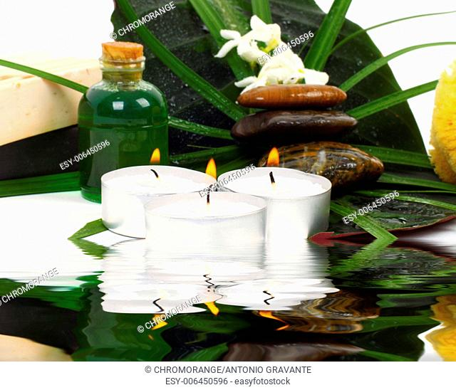 Accessories for spa with flowers of jasmine on white background