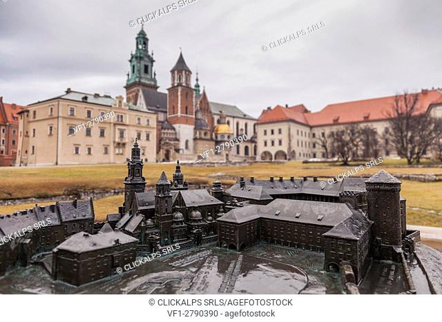 Krakow, Poland. Wawel castle and cathedral. In foreground there is a small model of castle and cathedral