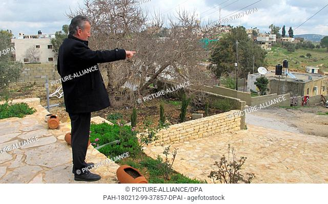 FILED - Bassem Tamimi points to the spot where his daughter Ahed Tamimi slapped two Israeli soldiers in Nabi Saleh, West Bank, 28 January 2018