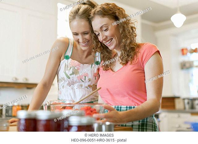 Sisters making fruit jam together