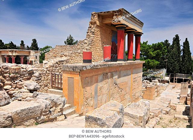Partial view of the Minoan Palace of Knossos with characteristic columns and a fresco of a bull behind. Crete, Greece