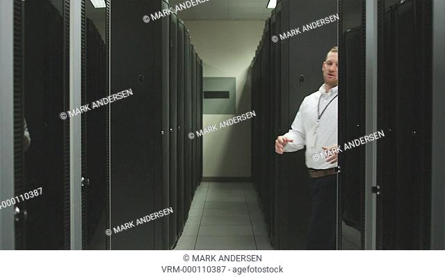 two people in a server room