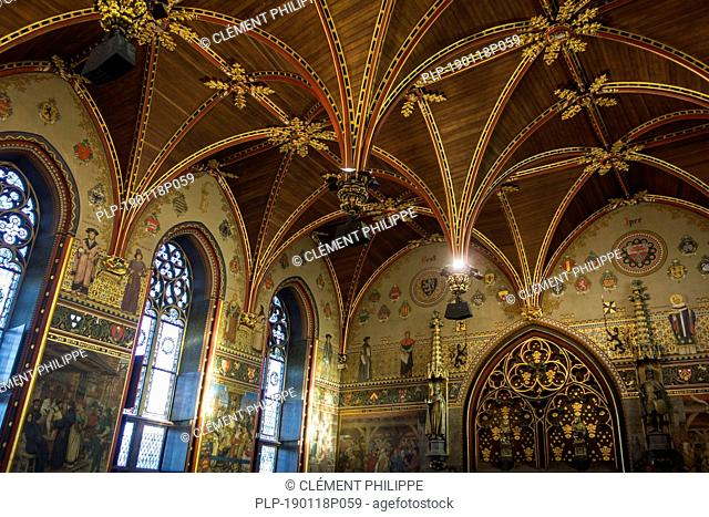 Interior of the city hall of Bruges showing the Gothic hall with polychrome vault and 19th century murals, West Flanders, Belgium