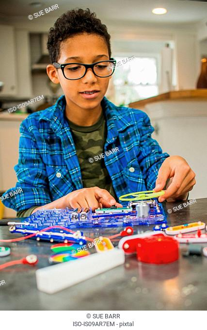 Boy working on science project at home