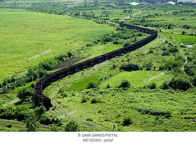 Long line of train wagons which were used for transportation on the former sugar cane plantation Manaca-Iznaga, Cuba