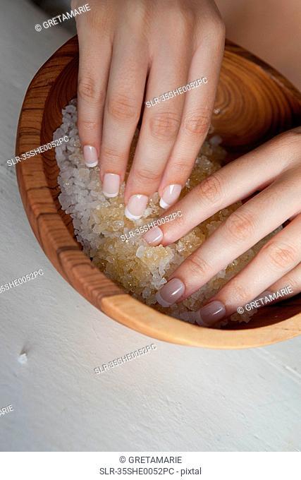 Woman touching bowl of sugar