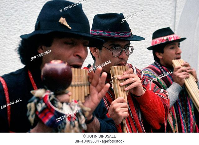 Band of street performers playing pan pipes