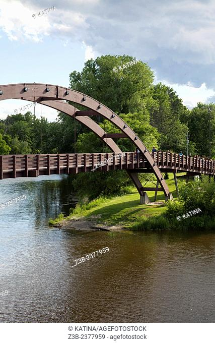 Summer along the Chippewa and Tittabawasse Rivers at The Tridge, a tourist attraction in downtown Midland, Tri-cities region of Michigan, MI, USA