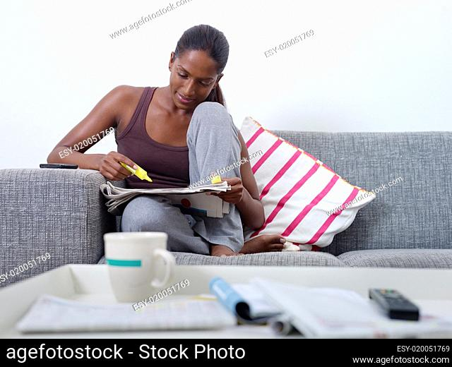 beautiful woman doing job hunting at home
