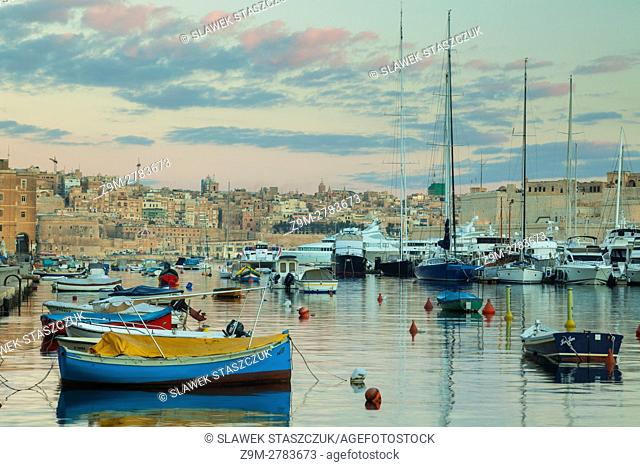 Morning at Vittoriosa Yacht Marina, Malta. Valletta skyline in the distance