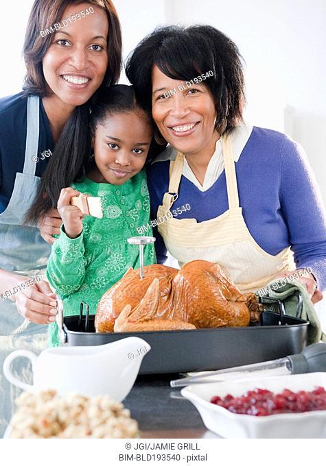 Black family preparing Thanksgiving dinner