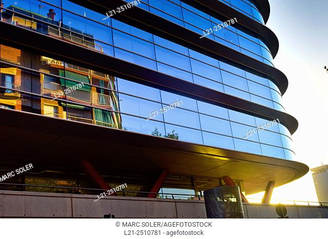 Modern building with reflective glass windows, detail. Las Arenas shopping center. Barcelona, Catalonia, Spain
