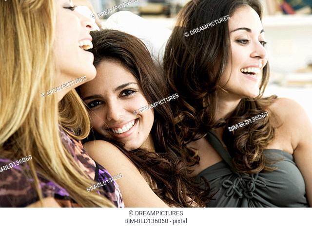 Hispanic women smiling together