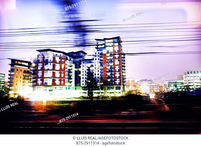 Blurred building and power lines. London, England