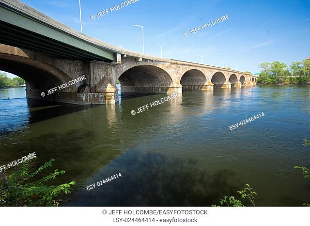 Arches of the Bulkeley Bridge connect Hartford and East Hartford across the Connecticut River on a sunny spring day