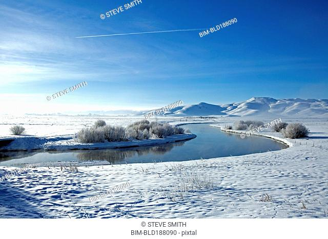 Snowy mountains and river in remote landscape