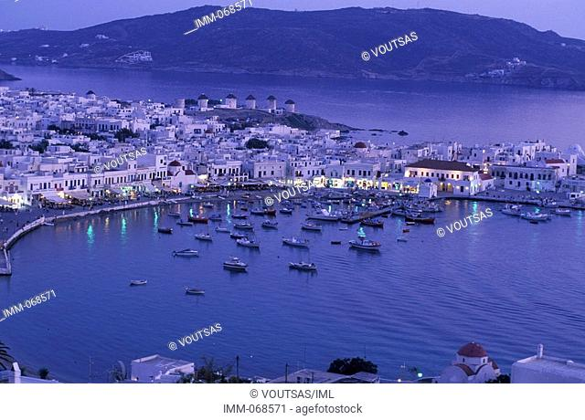 Cyclades, Mykonos Hora, general view of the town & harbor at dusk, windmills, boats