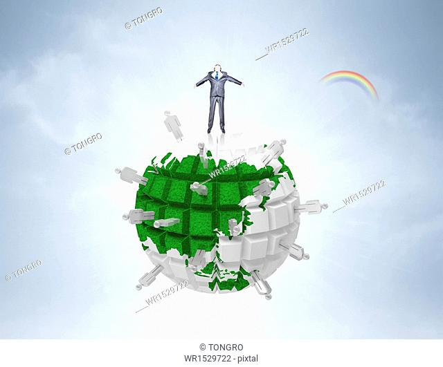 a business man standing on the globe