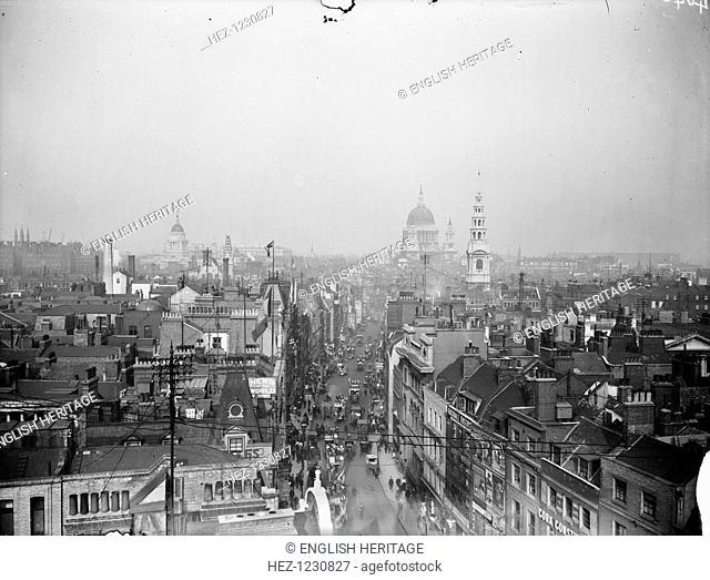 View looking east along Fleet Street from the tower of St Dunstan's church towards St Paul's Cathedral and the City. The street is busy with motorized and horse...