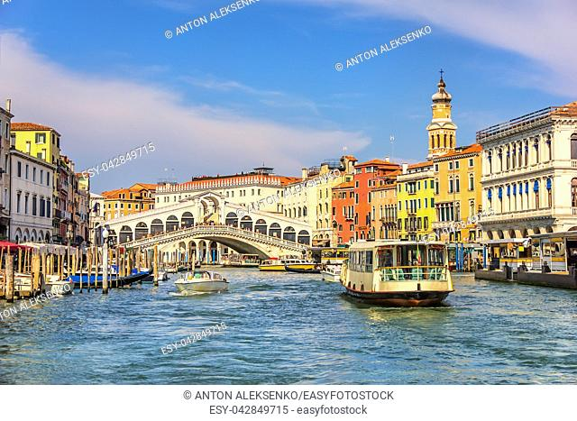 The Rialto Bridge and a vaporetto in a canal of Venice