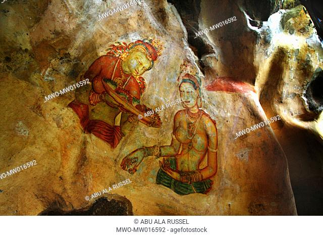 Frescos on the wall of Sigiriya rock, in Matale district of Sri Lanka This 370 meter high lava mound of an ancient volcano is famous for the fortified palace...