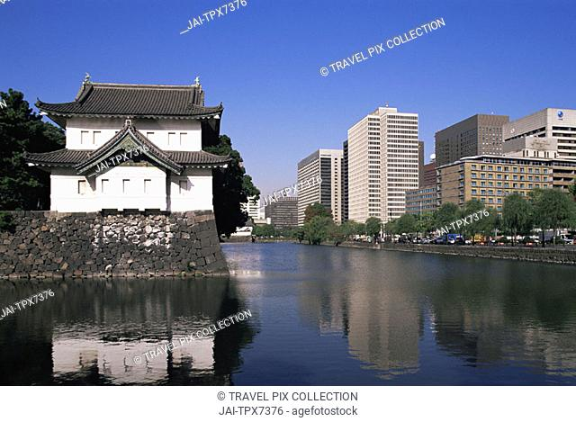 Japan, Honshu, Tokyo, Imperial Palace Moat and Otemachi Business Area Skyline