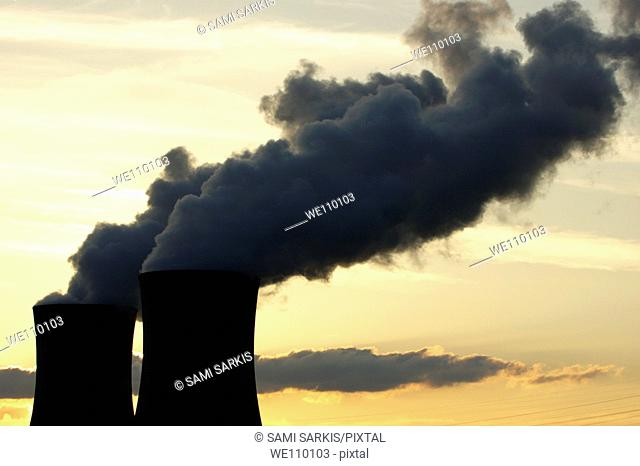 Smoke emitting from cooling towers at a nuclear power plant in the Rhone River Valley, Drome, France