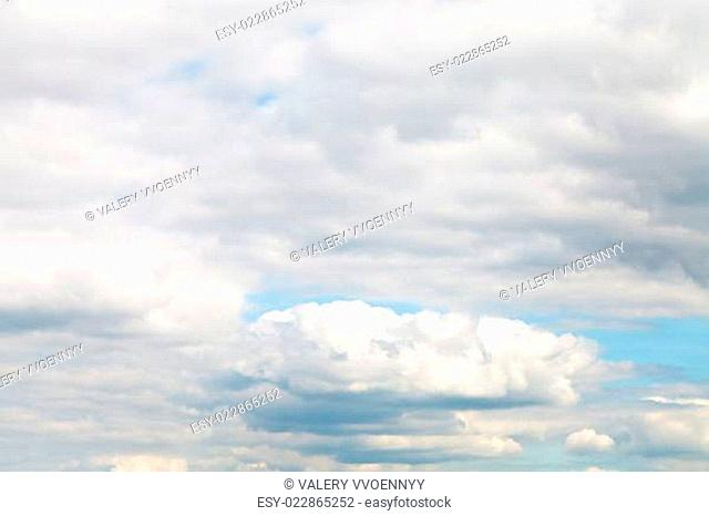 layers of white clouds in blue autumn sky