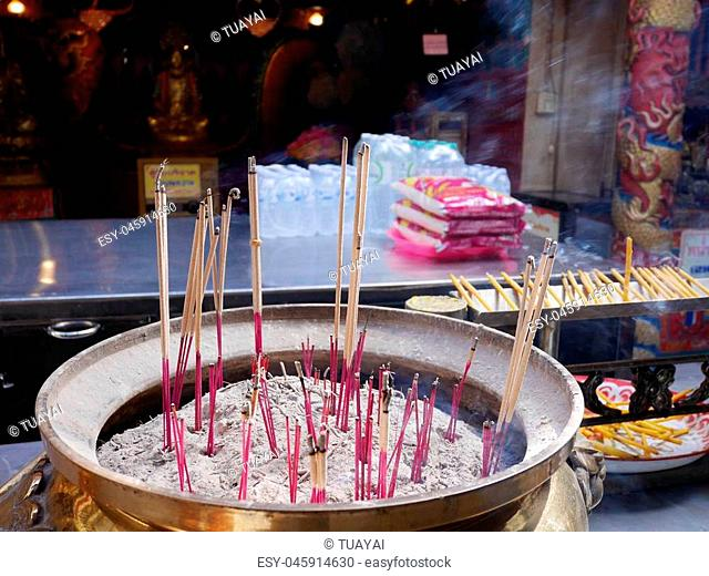 People prayer with candles incense sticks Stock Photos and Images
