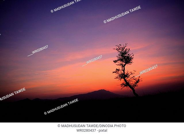 Sunset and mountain , Village Talegaon , District Pune , Maharashtra , India