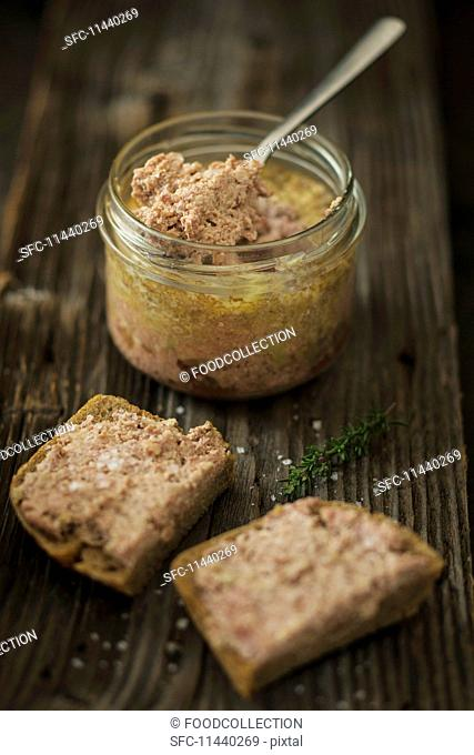 Goose liver pâté in a jar and on slices of bread