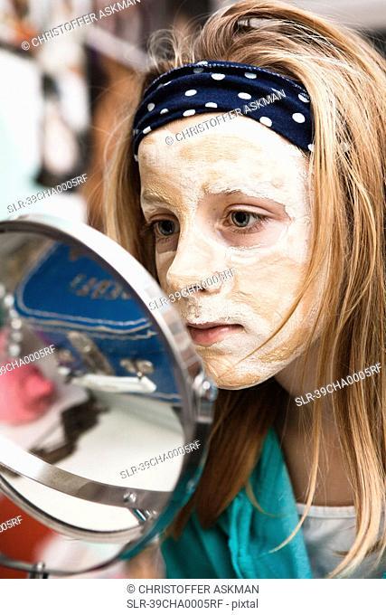 Girl using face mask in bedroom