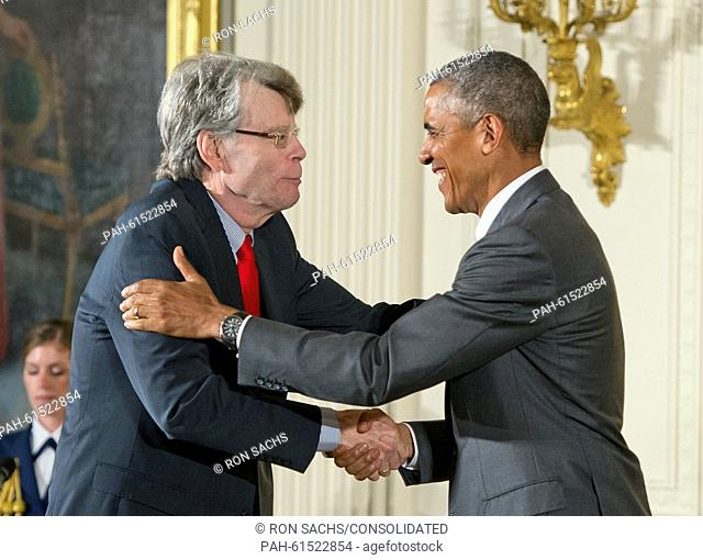 United States President Barack Obama presents the 2014 National Medal of Art to Stephen King of Bangor, Maine, author, during a ceremony in the East Room of the...