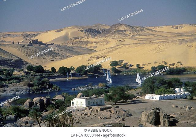 Elephantine Island. St Simeon's monastery. Felucca boats on River Nile. Trees. Buildings. Hills