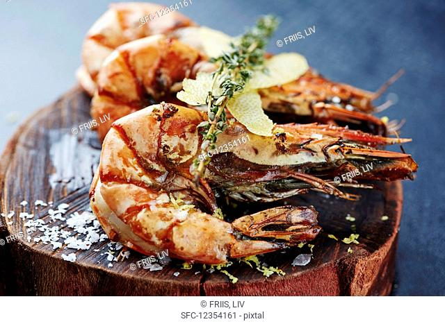 Grilled king prawns with thyme and lemon peel