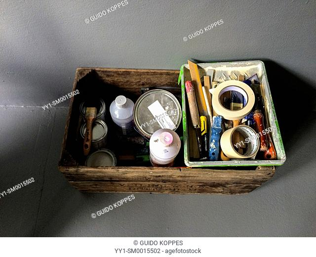 Tilburg, Netherlands. Wooden fruit crate with supplies and tools for in-house decorative painting