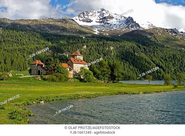 Crap da Sass castle in a spring landscape near the village Surlej at Lake Silvaplana, Switzerland