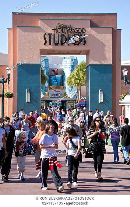 Orlando, FL - Feb 2009 - Park visitors walk under Disney's Hollywood Studios sign above walkway at Hollywood Studios theme park in Kissimmee Orlando Florida